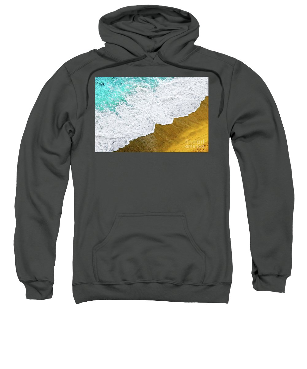 Water Sweatshirt featuring the photograph Footsteps In The Sand Hopelessly Facing The Rising Tide by Silvia Ganora