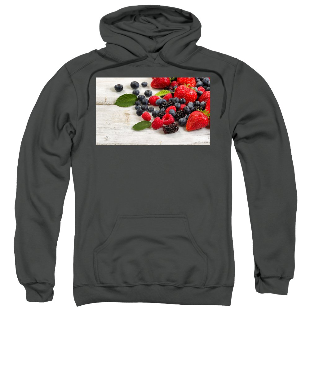 Strawberry Sweatshirt featuring the photograph Freshly Picked Berries On Rustic White Wooden Boards by Thomas Baker