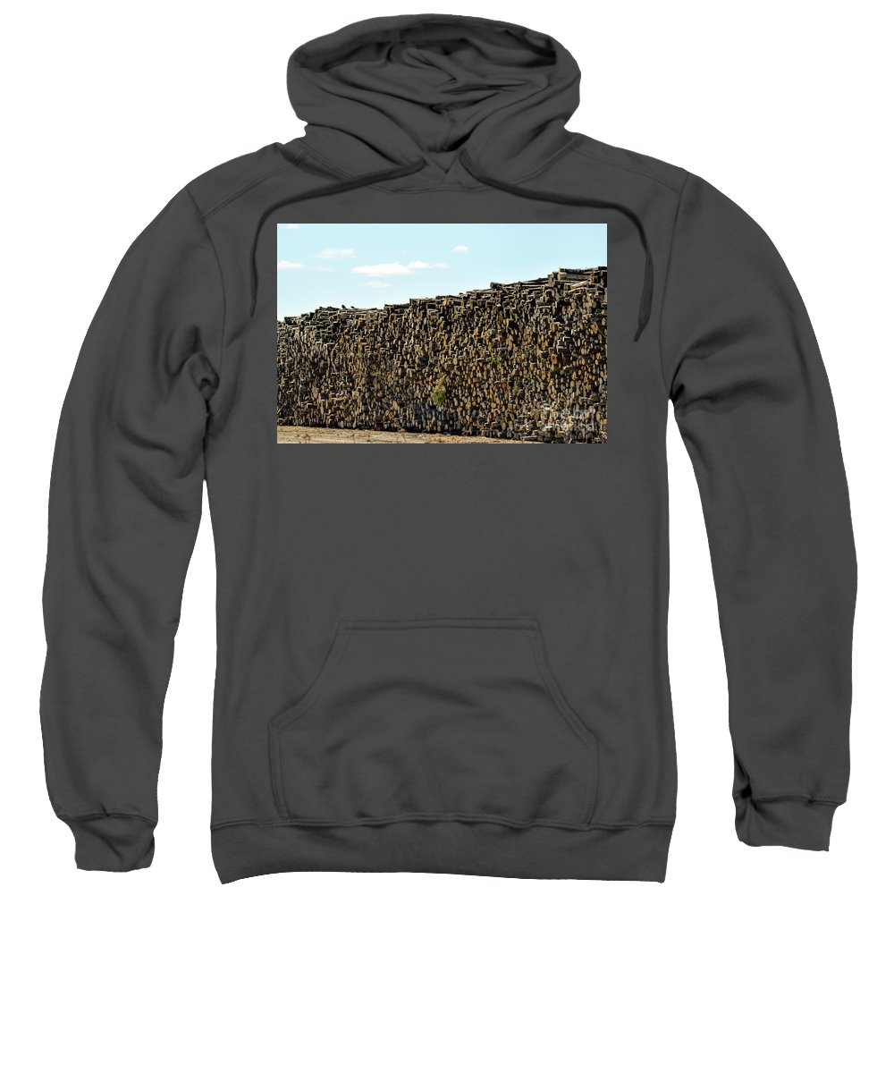 Cut Logs Sweatshirt featuring the photograph Factory Wood Piles by William Tasker