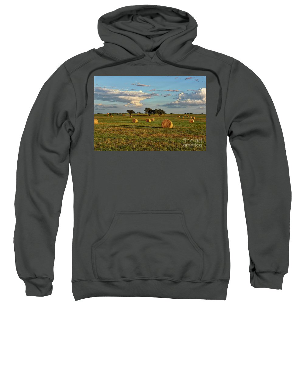Haybales Sweatshirt featuring the photograph Golden Glow Over Haybales by Tod and Cynthia Grubbs