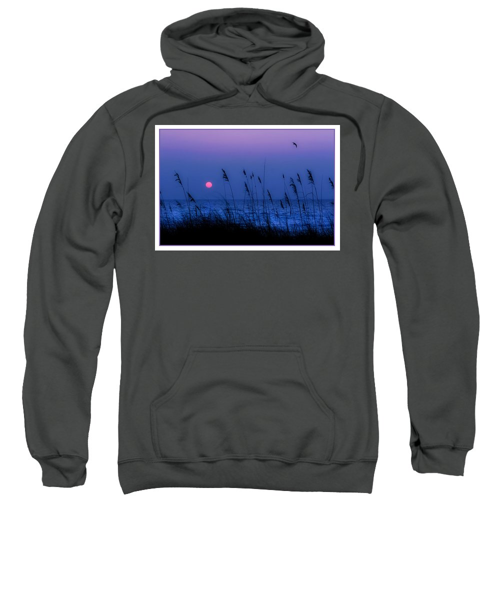 Grass Sweatshirt featuring the photograph Grasses Frame The Setting Sun In Florida by Mal Bray
