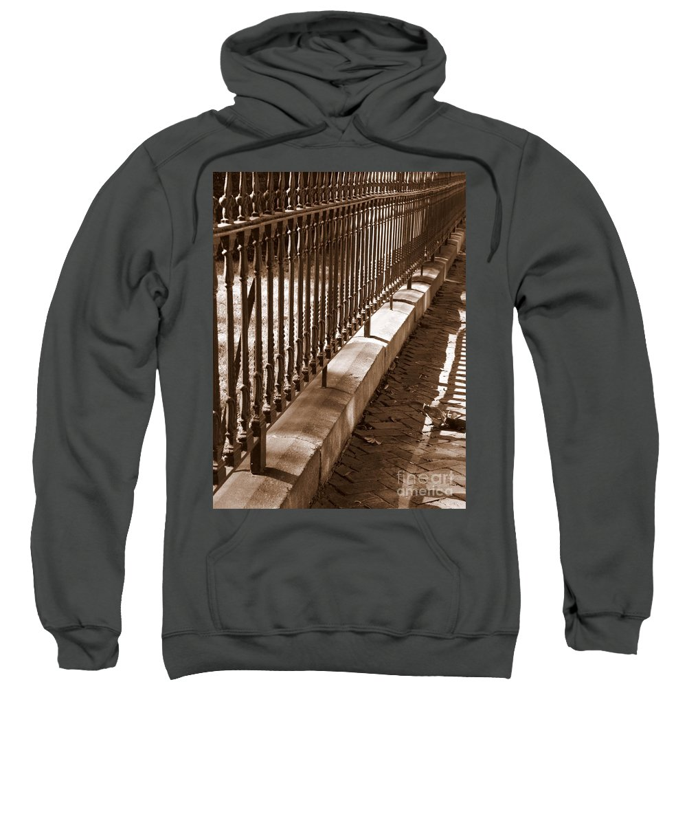 Wrought Iron Fence Sweatshirt featuring the photograph Iron Fence With Shadows by Carol Groenen