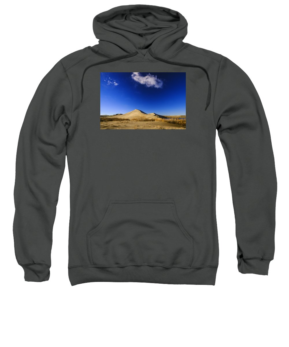 Mountain Home Sweatshirt featuring the photograph Lonely Cloud Over Sand Dunes At Bruneau Dunes State Park Idaho Usa by Vishwanath Bhat