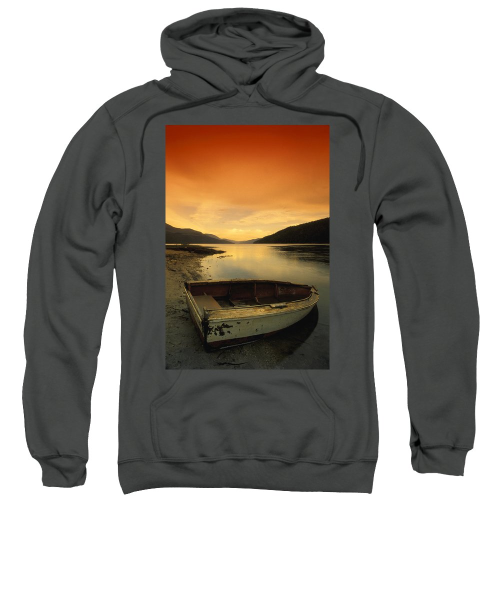 Abandoned Sweatshirt featuring the photograph Old Rowboat At Waters Edge With Sunset by Don Hammond