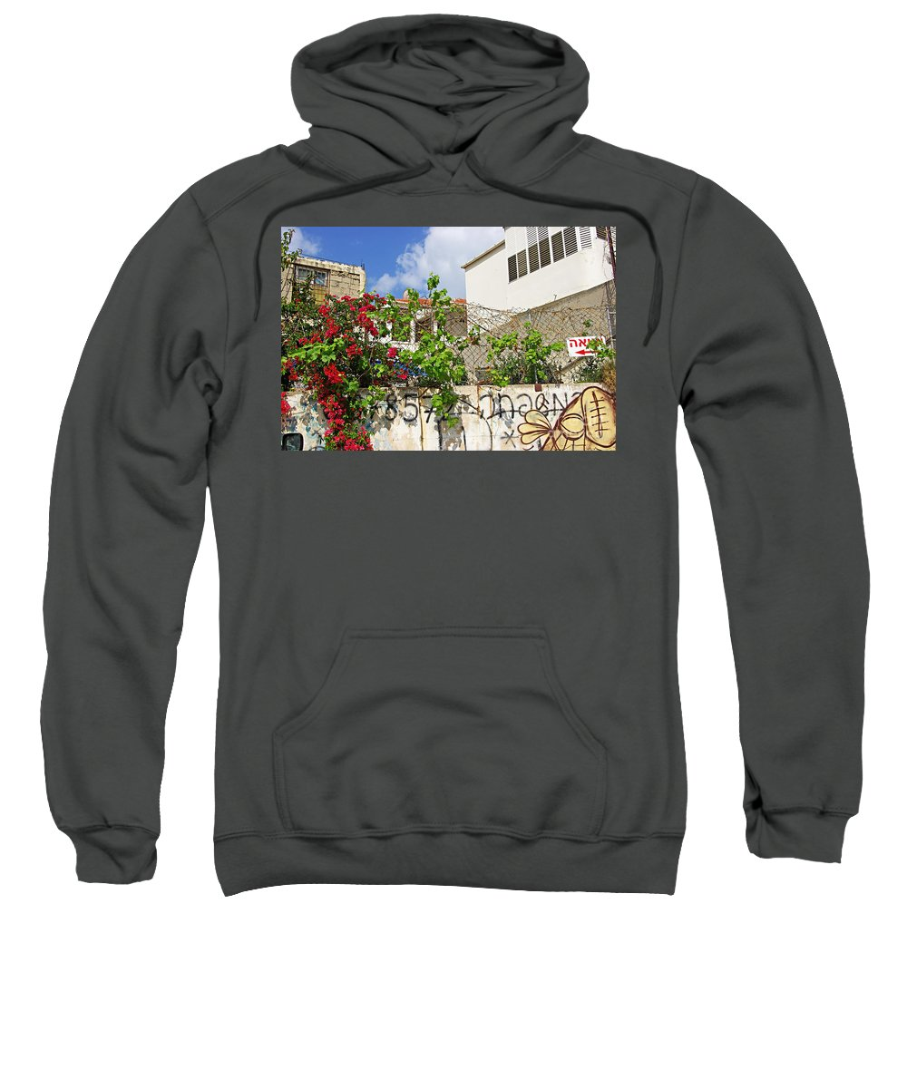 Red Sweatshirt featuring the photograph Red Flowers On A Wall by Zal Latzkovich