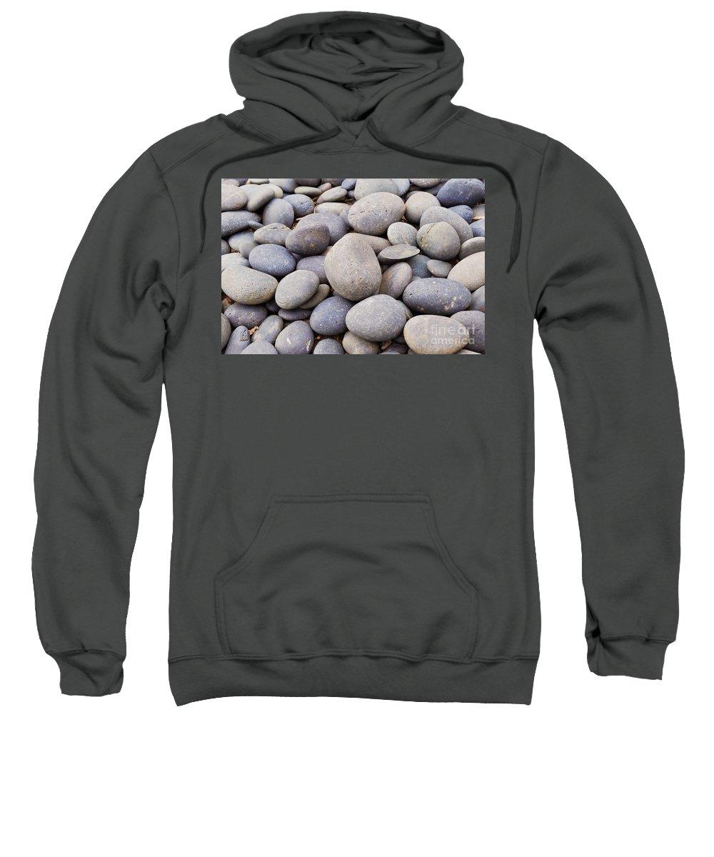 Rocks Stones Background Landscape Texture Pebbles Seashore Sweatshirt featuring the photograph Rocks by Thomas Deskins