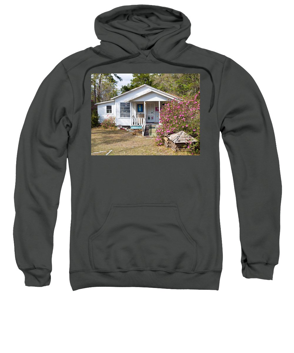Cabin Sweatshirt featuring the photograph Santa And Mrs Claus Spend The Spring Months Relaxing by Allan Hughes
