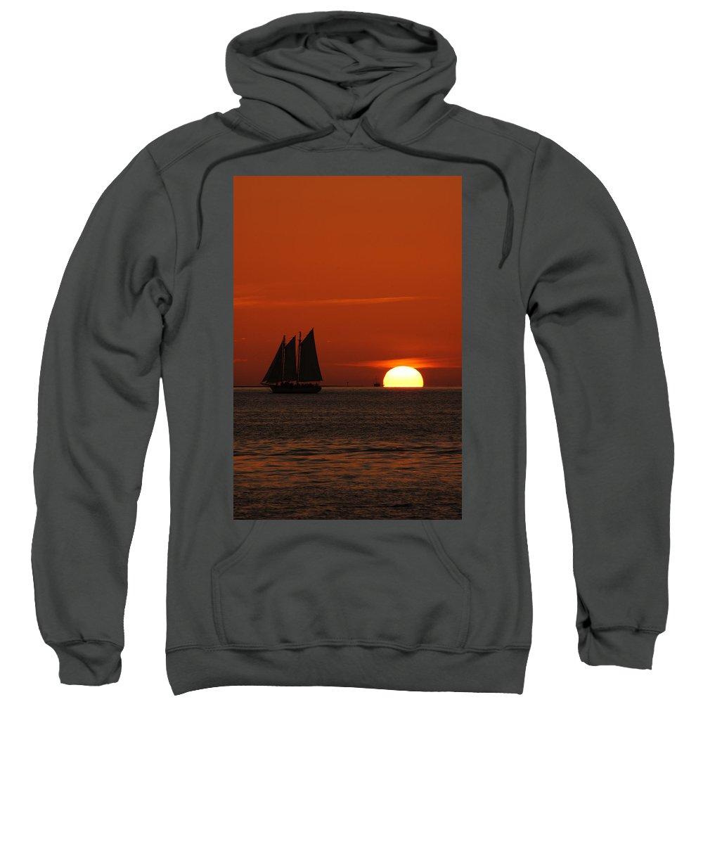 Schooner In Red Sunset Sweatshirt featuring the photograph Schooner In Red Sunset by Susanne Van Hulst