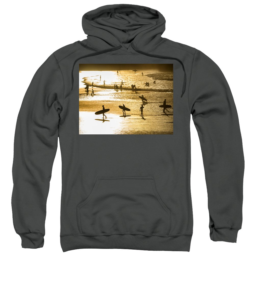 Surfing Sweatshirt featuring the photograph Silhouette Of Surfers At Sunset by Curtis Patterson