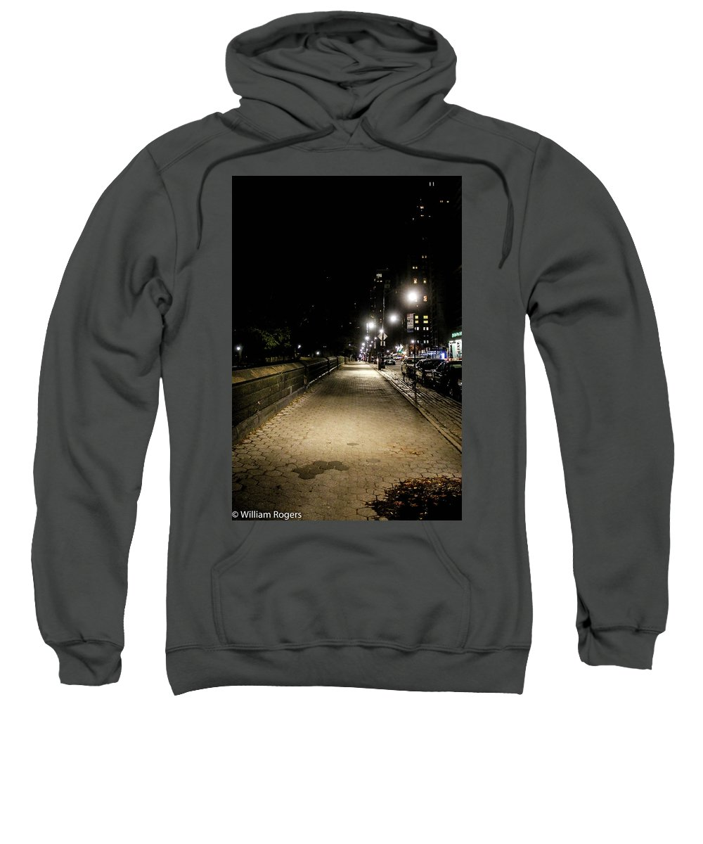 This Is A Photo Of The Sidewalk Outside Of Central Park Sweatshirt featuring the photograph The Lonely Street By Central Park Ny by William Rogers