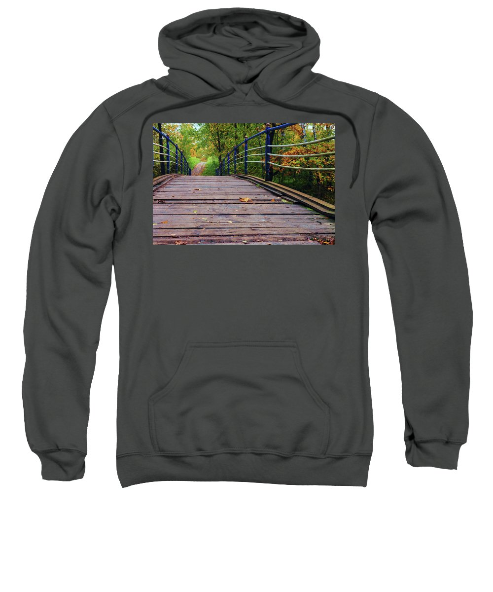 George Westermak Sweatshirt featuring the photograph the old bridge over the river invites for a leisurely stroll in the autumn Park by George Westermak