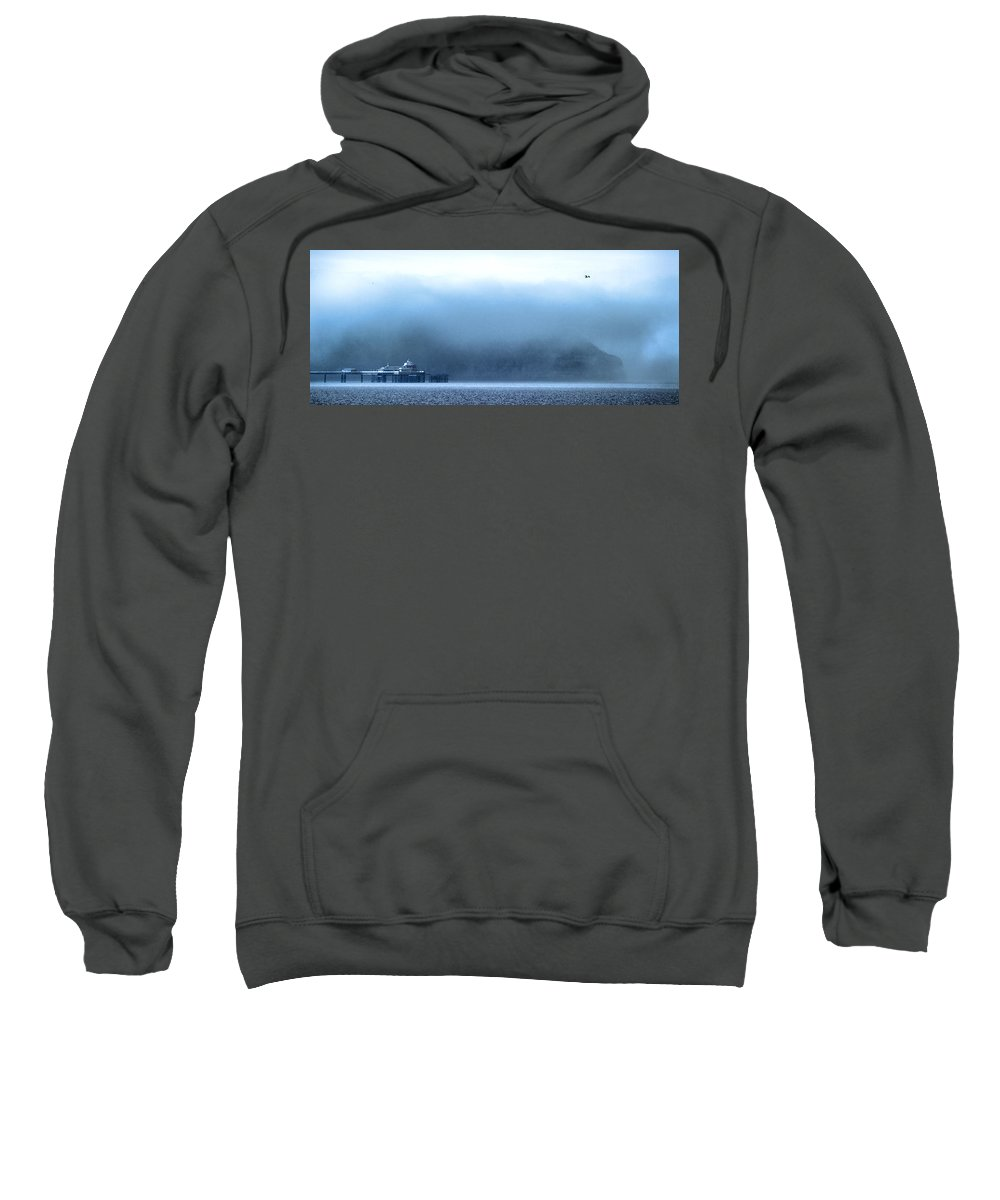 Pier Sweatshirt featuring the photograph The Sea Mist Lifts To Reveal The Great Orme Behind Llandudno Pier by Mal Bray