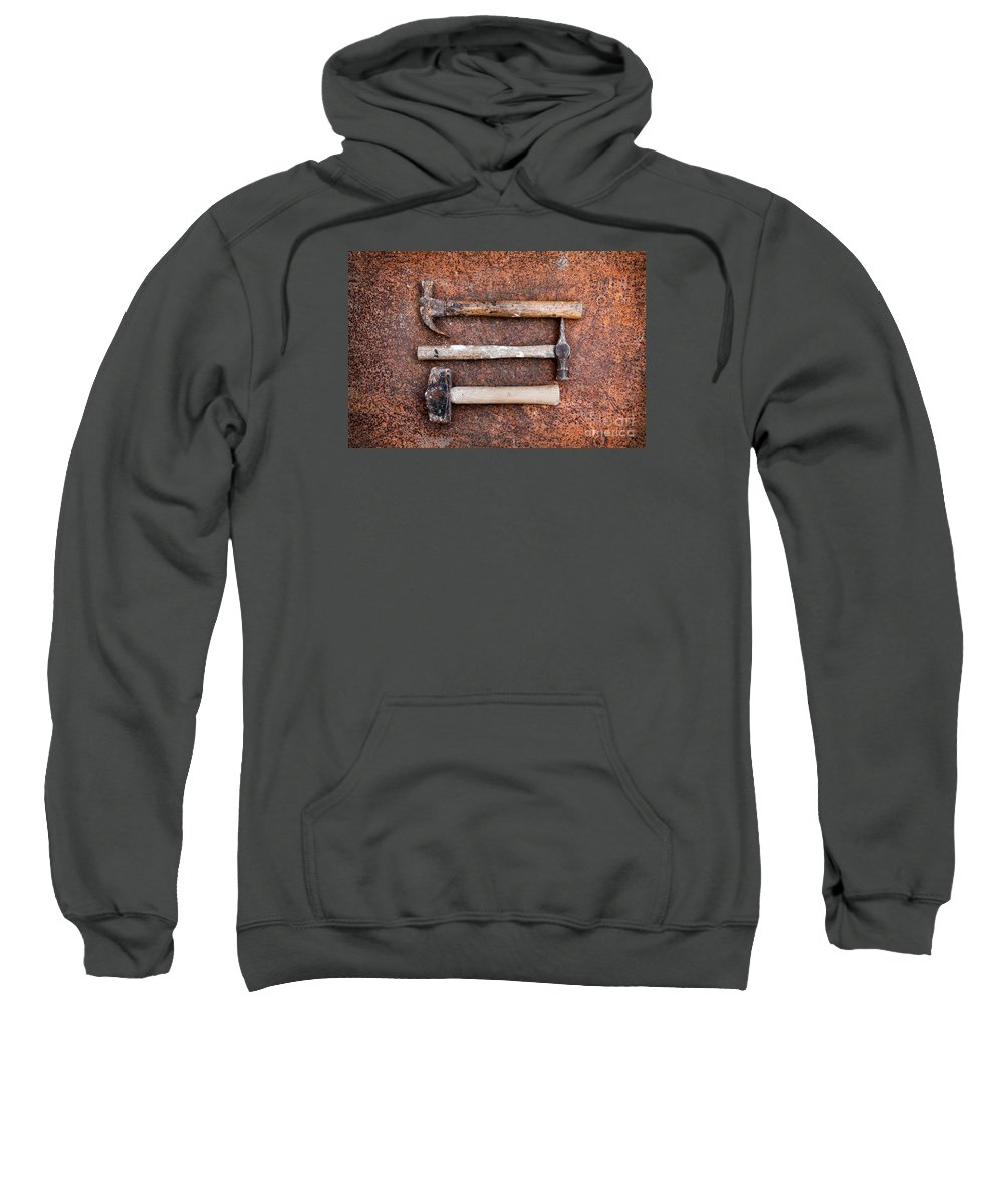 Still Life Sweatshirt featuring the photograph Three Hammers Against A Rust Background by Jacqueline Moore