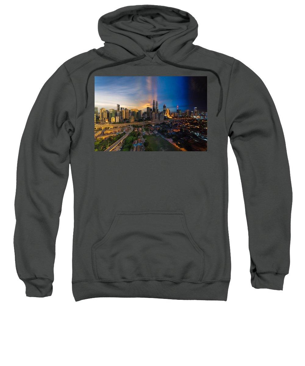Kuala Lumpur Sweatshirt featuring the photograph Timeslice Of Day To Night Of Kuala Lumpur City by Ahmad Hafidz Abdul Kadir
