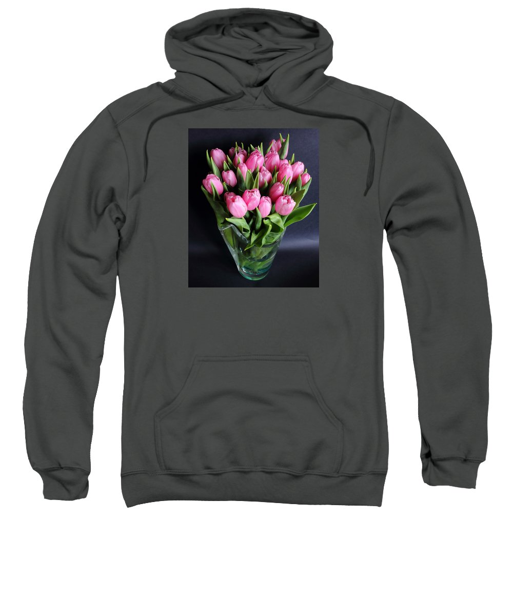 Flowers Tulips Stems Blooms Pink Green Cut Flowers Petals Glass Vase Water Black Background Symmetrical Shape Form Sweatshirt featuring the photograph Tulips In A Glass Vase by Jeff Townsend
