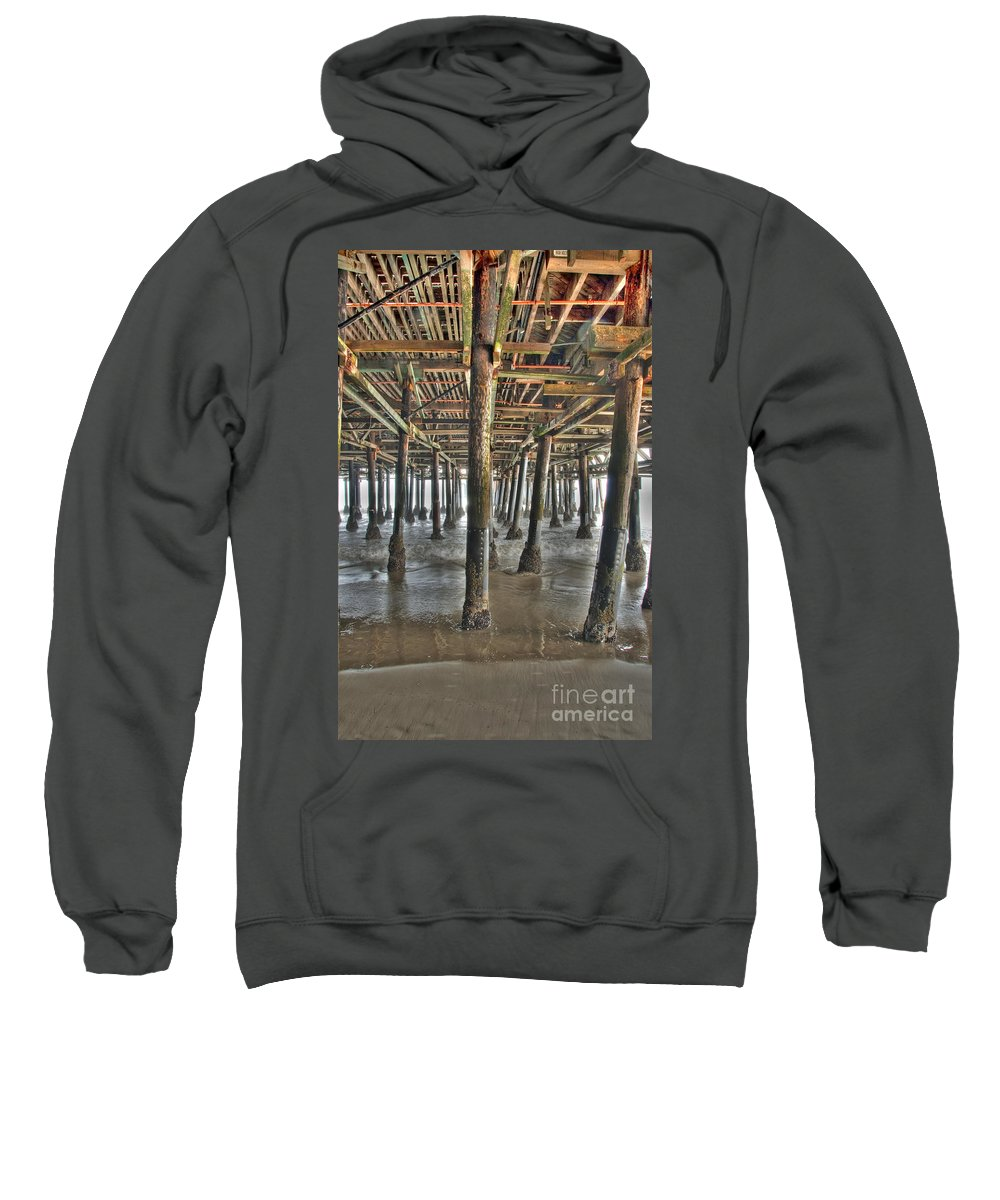 Under The Boardwalk Sweatshirt featuring the photograph Under The Boardwalk Pier Sunbeams by David Zanzinger