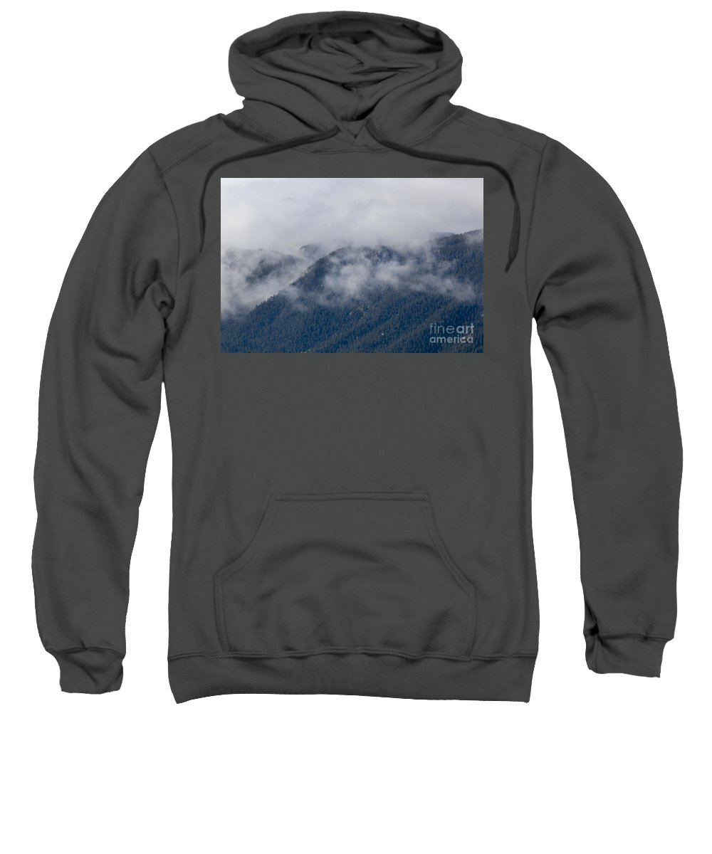 Ute Pass Sweatshirt featuring the photograph Ute Pass As Storm Clouds And Fog Roll In by Steve Krull