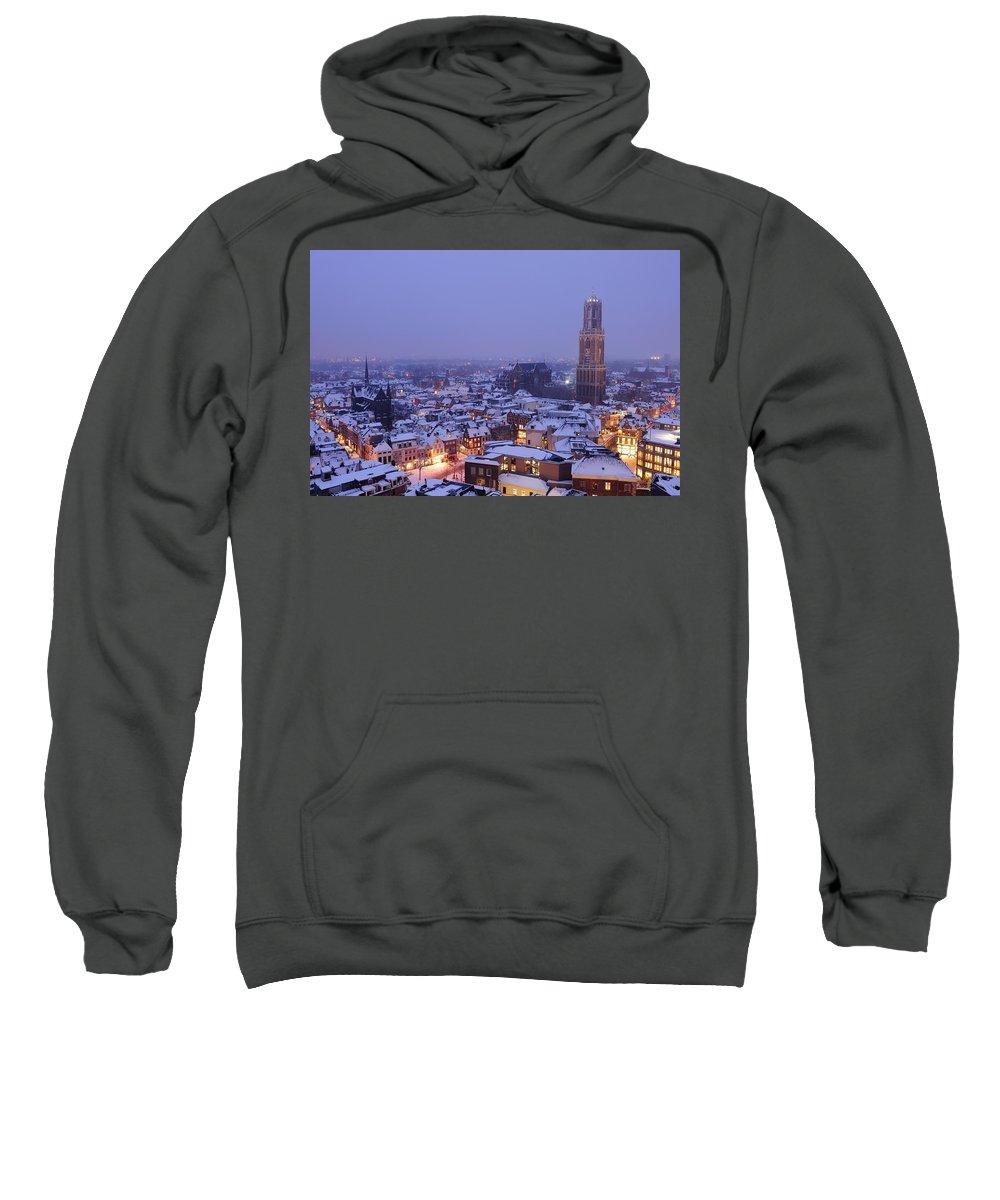 Snow Sweatshirt featuring the photograph Winter Cityscape Of Utrecht In The Evening 14 by Merijn Van der Vliet