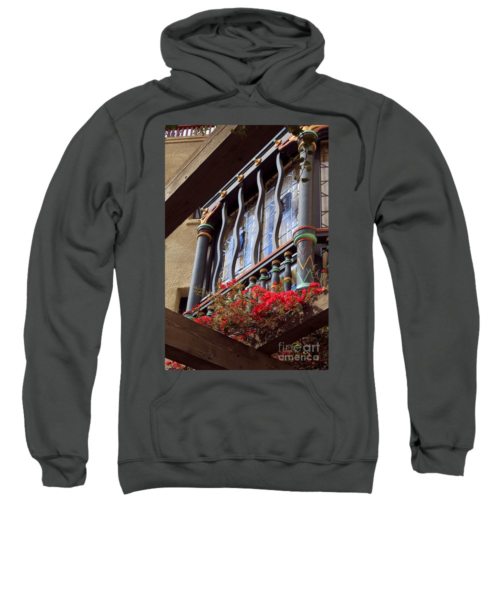 Architectural Sweatshirt featuring the photograph Wood Beams Red Flowers And Blue Window by James Eddy