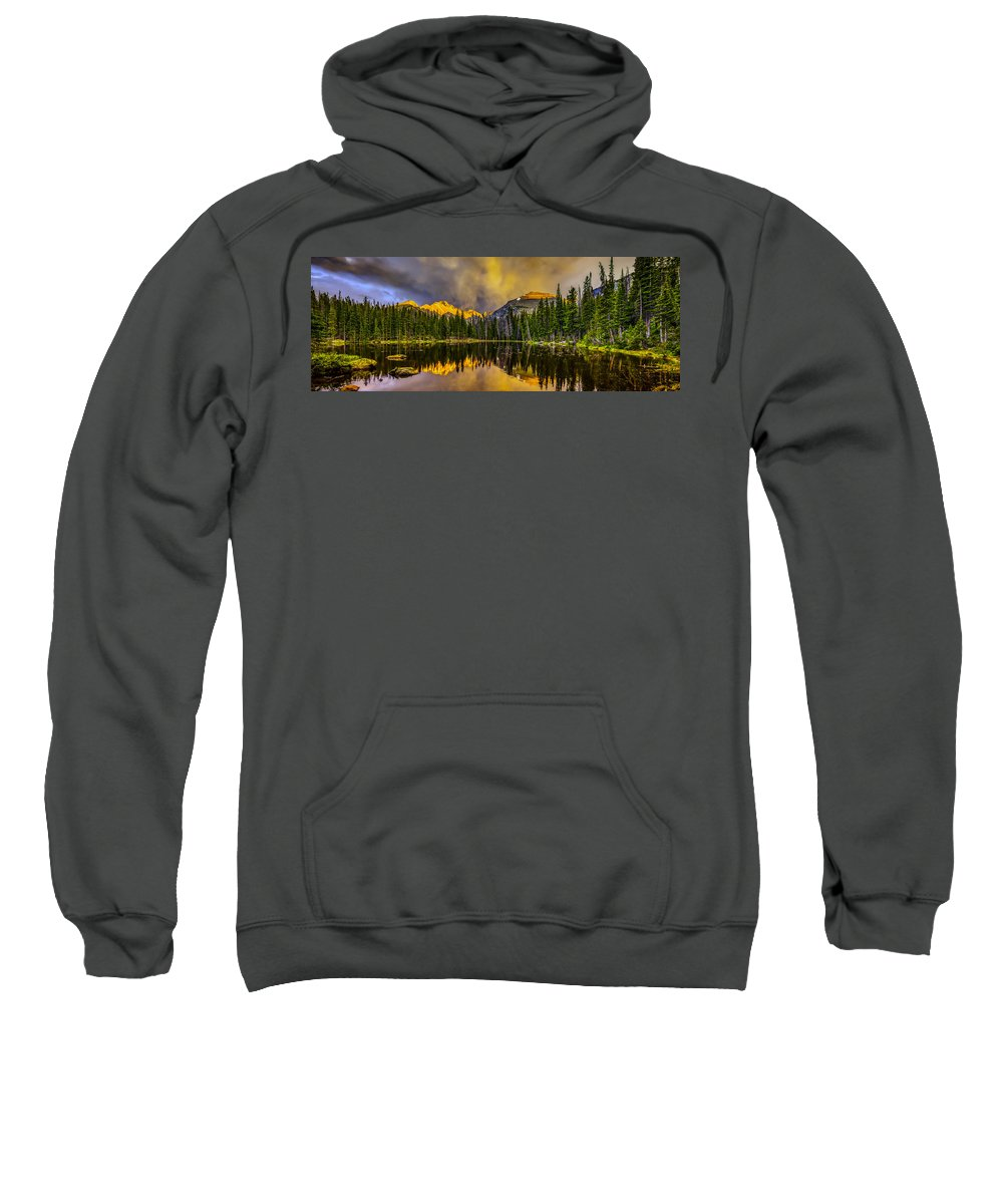 Mountain Sweatshirt featuring the photograph Stormy Sunset by Fred J Lord