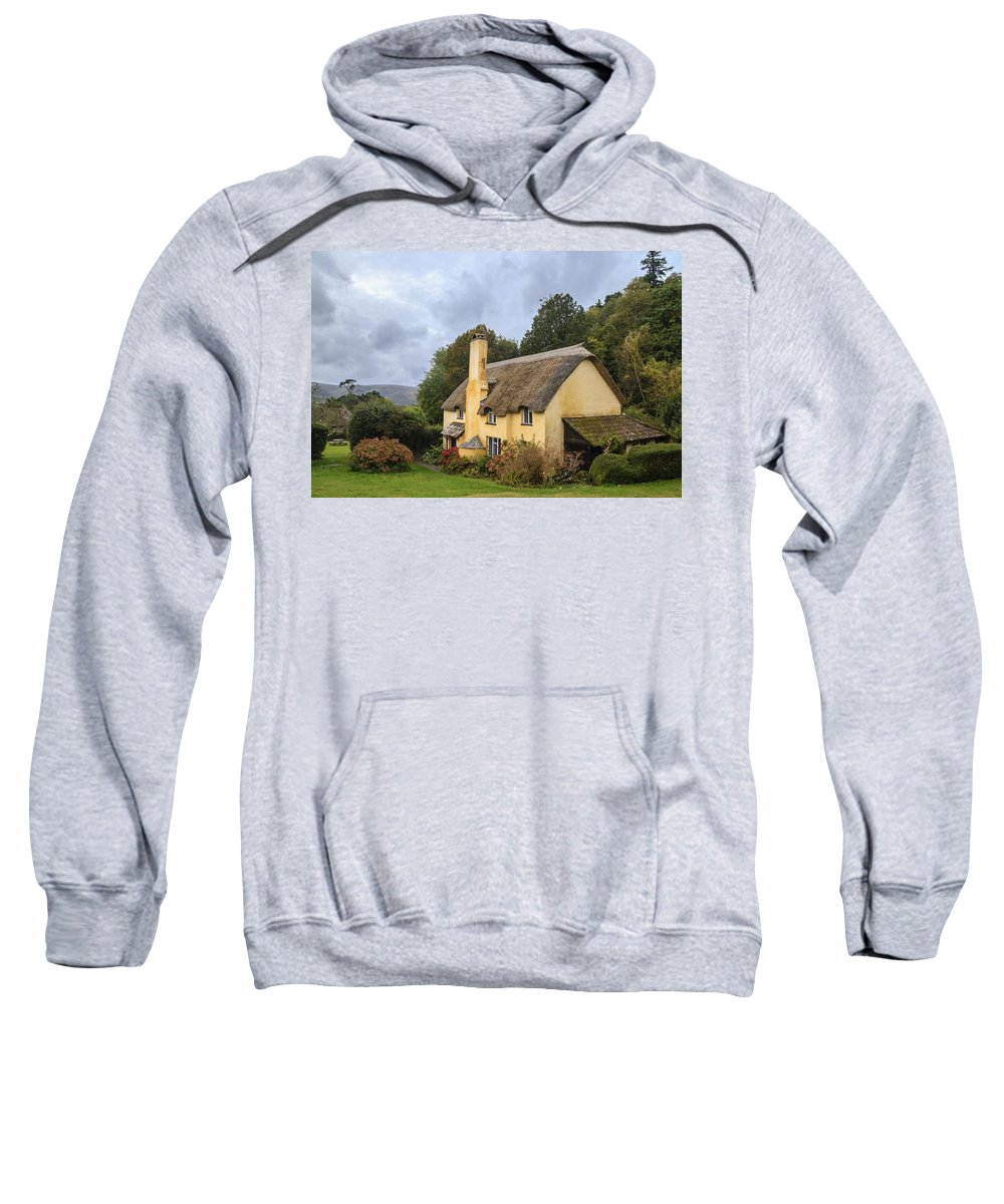 Somerset Sweatshirt featuring the photograph Picturesque Thatched Roof Cottage In Selworthy by Chris Smith