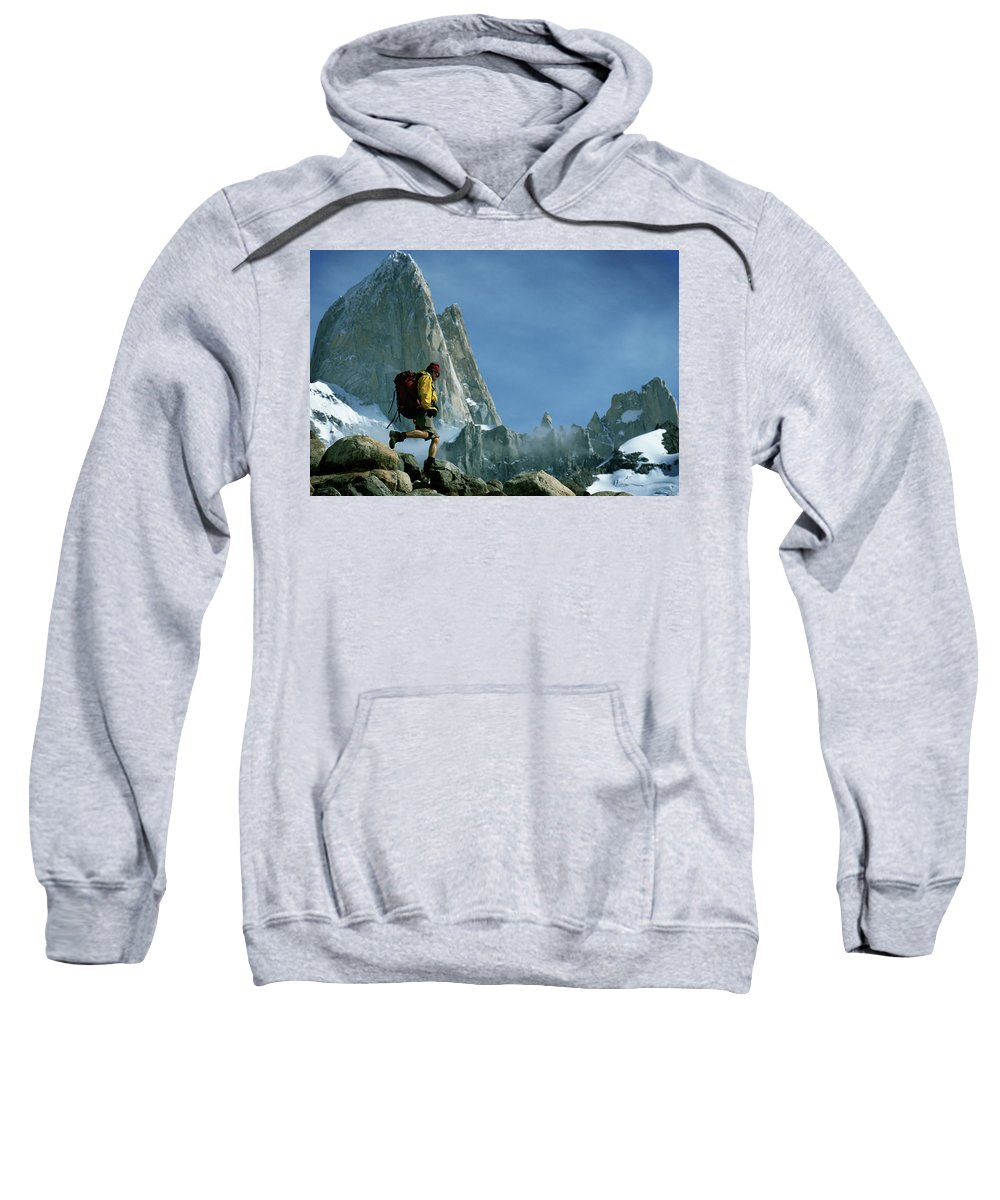 25-35 Years Sweatshirt featuring the photograph A Man Backpacks In Front Of Fitz Roy by Ty Milford
