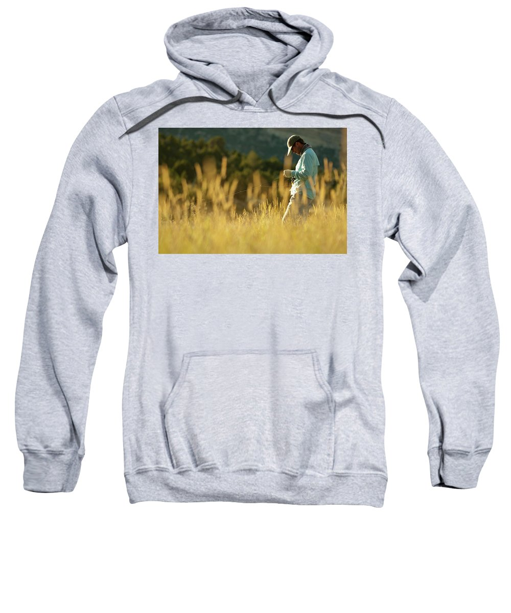 35-39 Years Sweatshirt featuring the photograph A Young Man Fly-fishing At Sunset by Jeff Diener