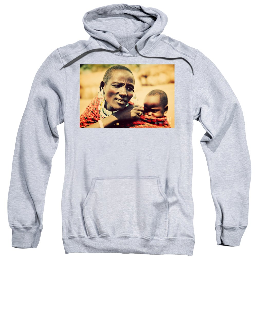 Africa Sweatshirt featuring the photograph Maasai Baby Carried By His Mother In Tanzania by Michal Bednarek