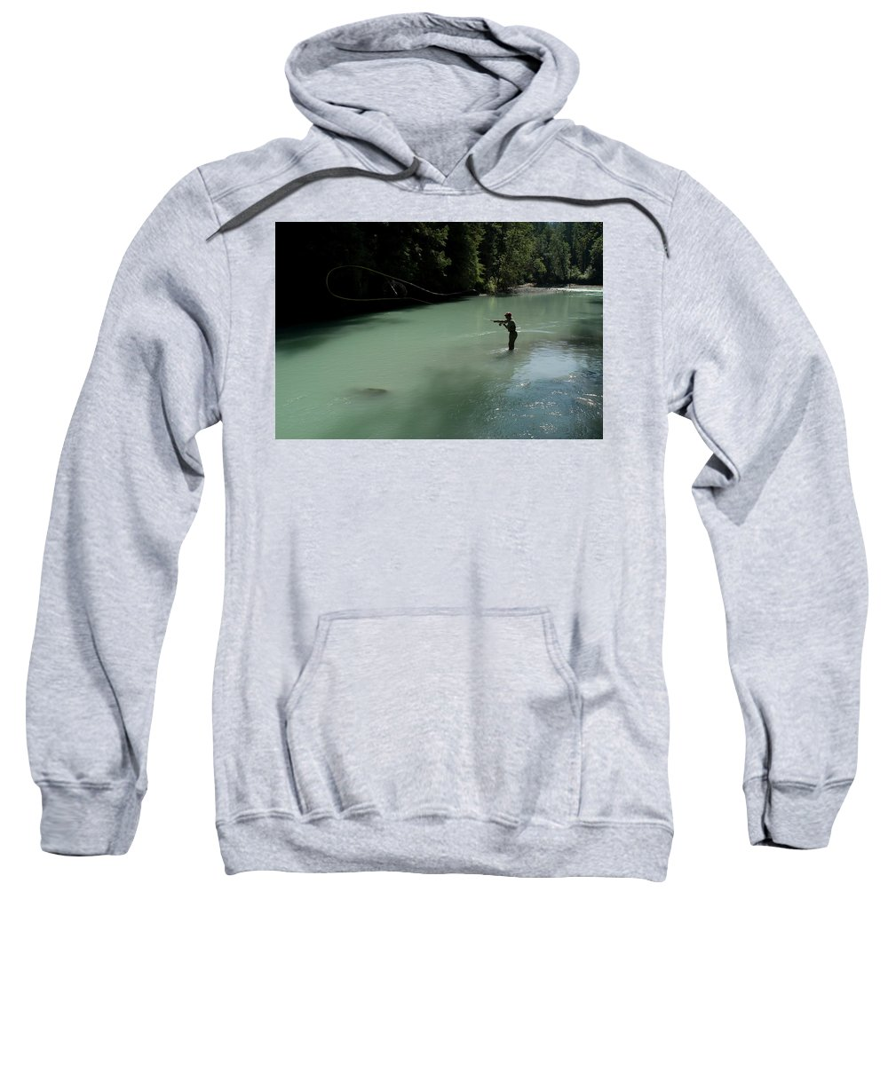 Adult Sweatshirt featuring the photograph A Man Casts In A River Wearing Waders by Alain Denis