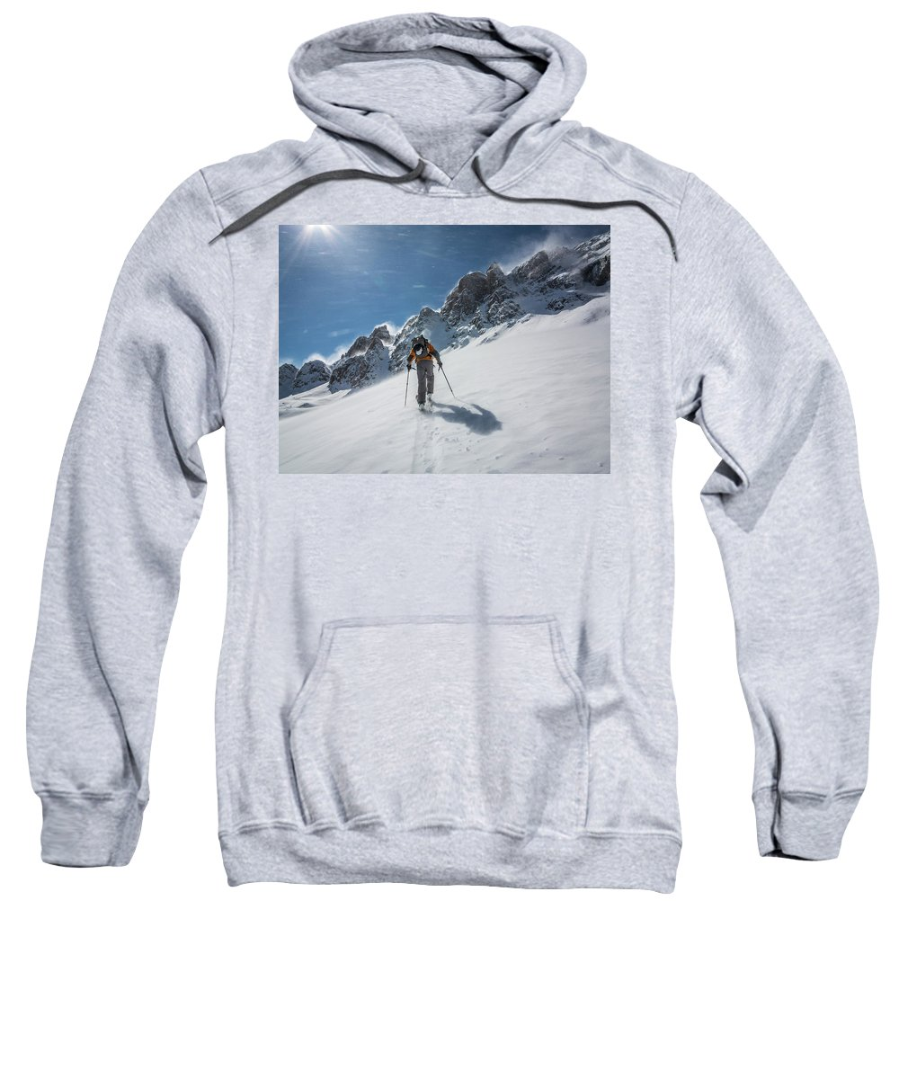 Adventure Sweatshirt featuring the photograph A Man Ski Touring In The Mountains by Whit Richardson