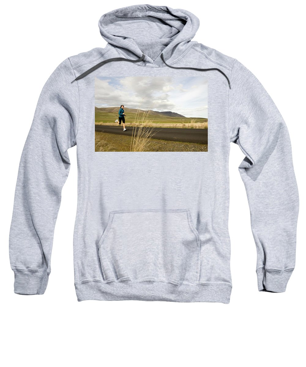 Adult Sweatshirt featuring the photograph A Woman Out For A Jog In The Country by Jordan SIemens