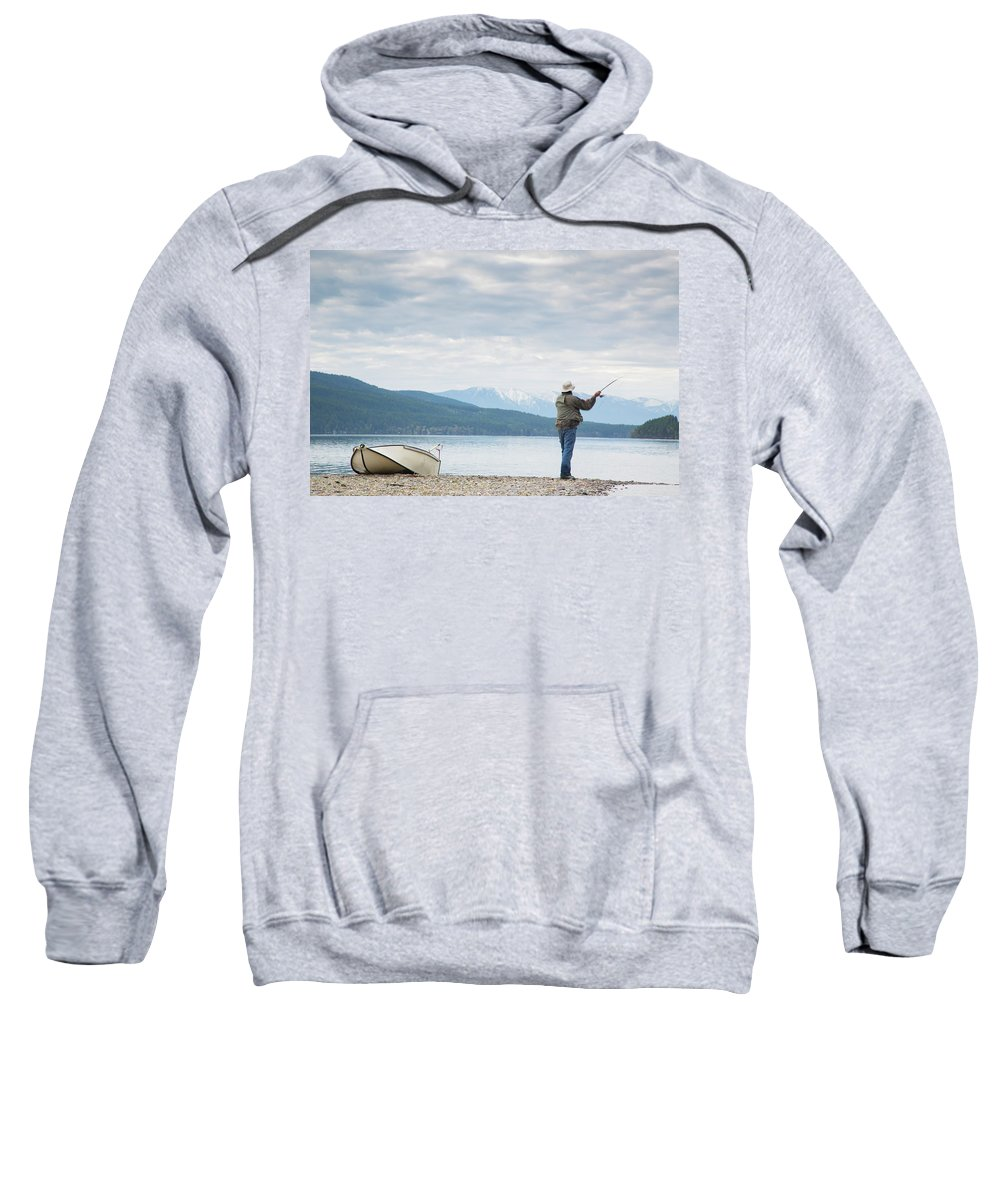 30-34 Years Sweatshirt featuring the photograph A Man Fishing On Whitefish Lake by Craig Moore
