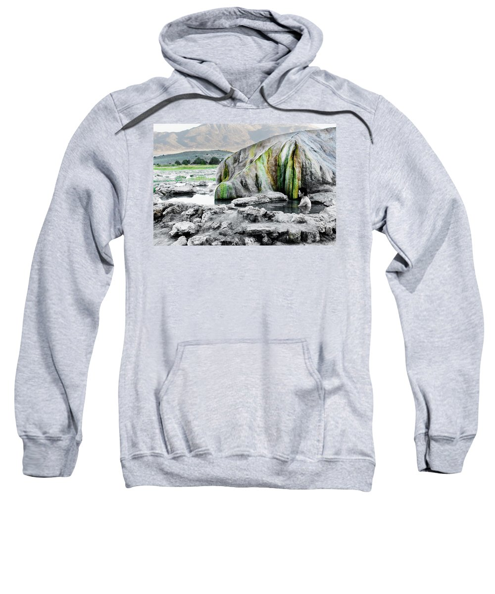 50-54 Years Sweatshirt featuring the photograph A Woman Sits Alone In Travertine Hot by Ron Koeberer