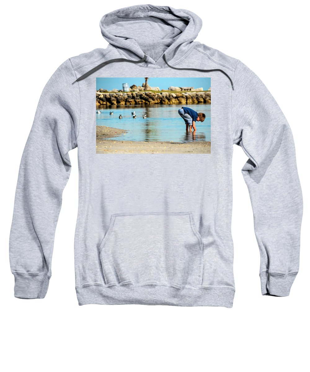 Childhood Sweatshirt featuring the photograph A Boy Searches The Water At Matheson by Molly Steinwald