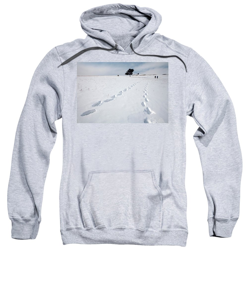 Cloudy Sky Sweatshirt featuring the photograph A Couple Walking In The Snow by Olivier Renck