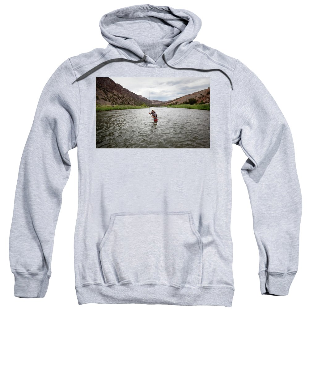 30-34 Years Sweatshirt featuring the photograph A Fly Fisherman Mends While Fishing by Ryan Heffernan