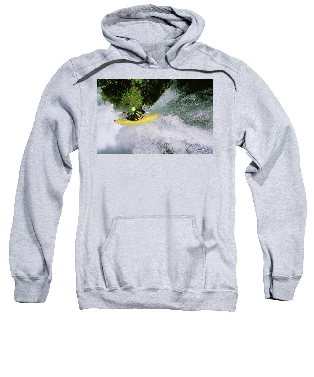 Adventure Sweatshirt featuring the photograph A Kayaker Running A Beautiful Spirit by Charlie Munsey