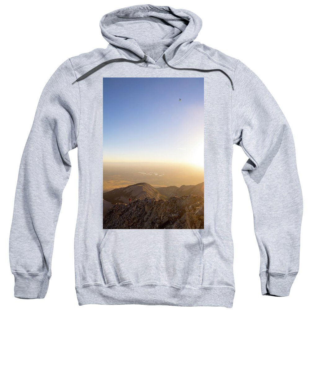 One Person Sweatshirt featuring the photograph A Man Flying Kite On Summit Of Little by Kennan Harvey