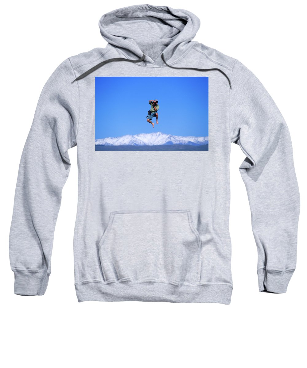Acrobatics Sweatshirt featuring the photograph A Man Takes A Photo While Jumping by Corey Rich
