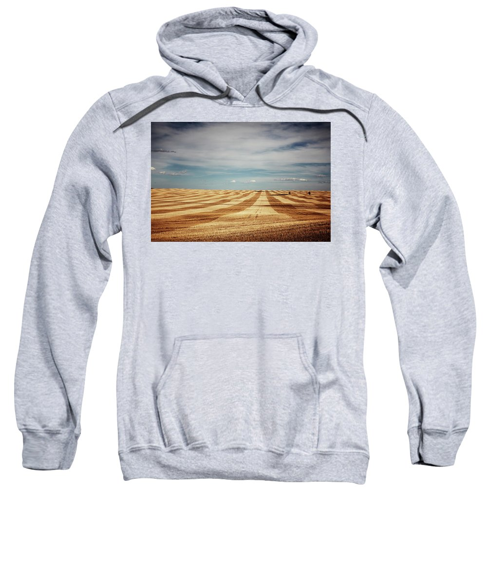 Agriculture Sweatshirt featuring the photograph A Pattern Of Stripes Across A Farmers by Todd Korol