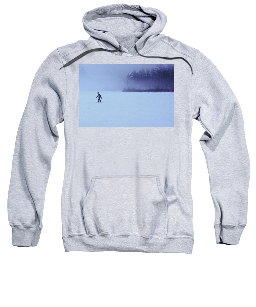 Blue Sweatshirt featuring the photograph A Young Boy Walks Across The Frozen by Jose Azel