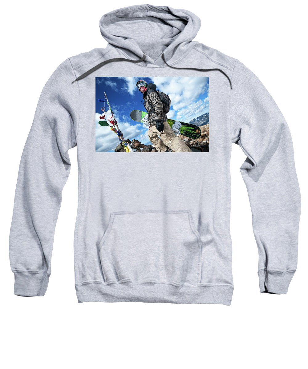Cold Sweatshirt featuring the photograph An Extreme Snowboarder Stands by Bud Force