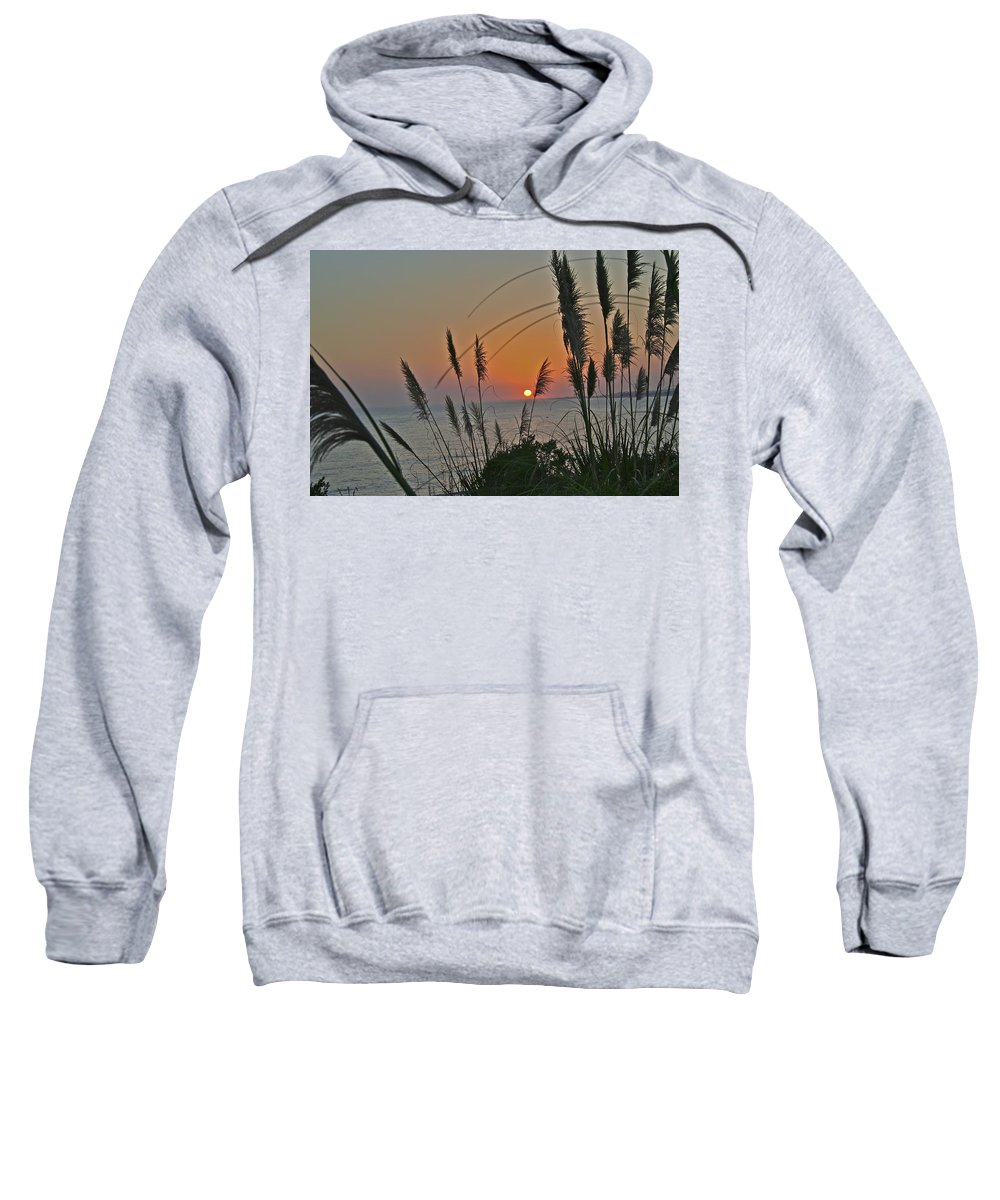 Sunset Sweatshirt featuring the photograph as the sun sets at Seascape by SC Heffner