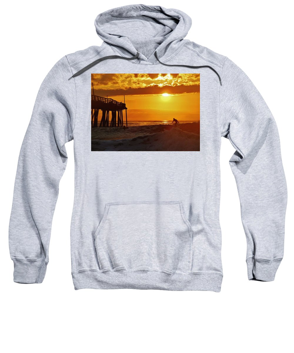 Mark Lemmon Cape Hatteras Nc The Outer Banks Photographer Subjects From Sunrise Sweatshirt featuring the photograph Avon Pier Sunrise Surfer 2 9/08 by Mark Lemmon