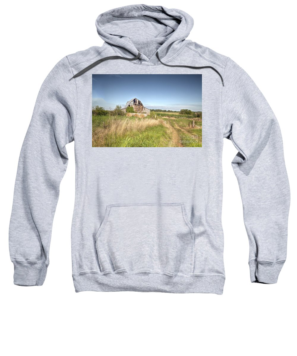 2013 Sweatshirt featuring the photograph Barn In A Field With Hay Bales by Larry Braun