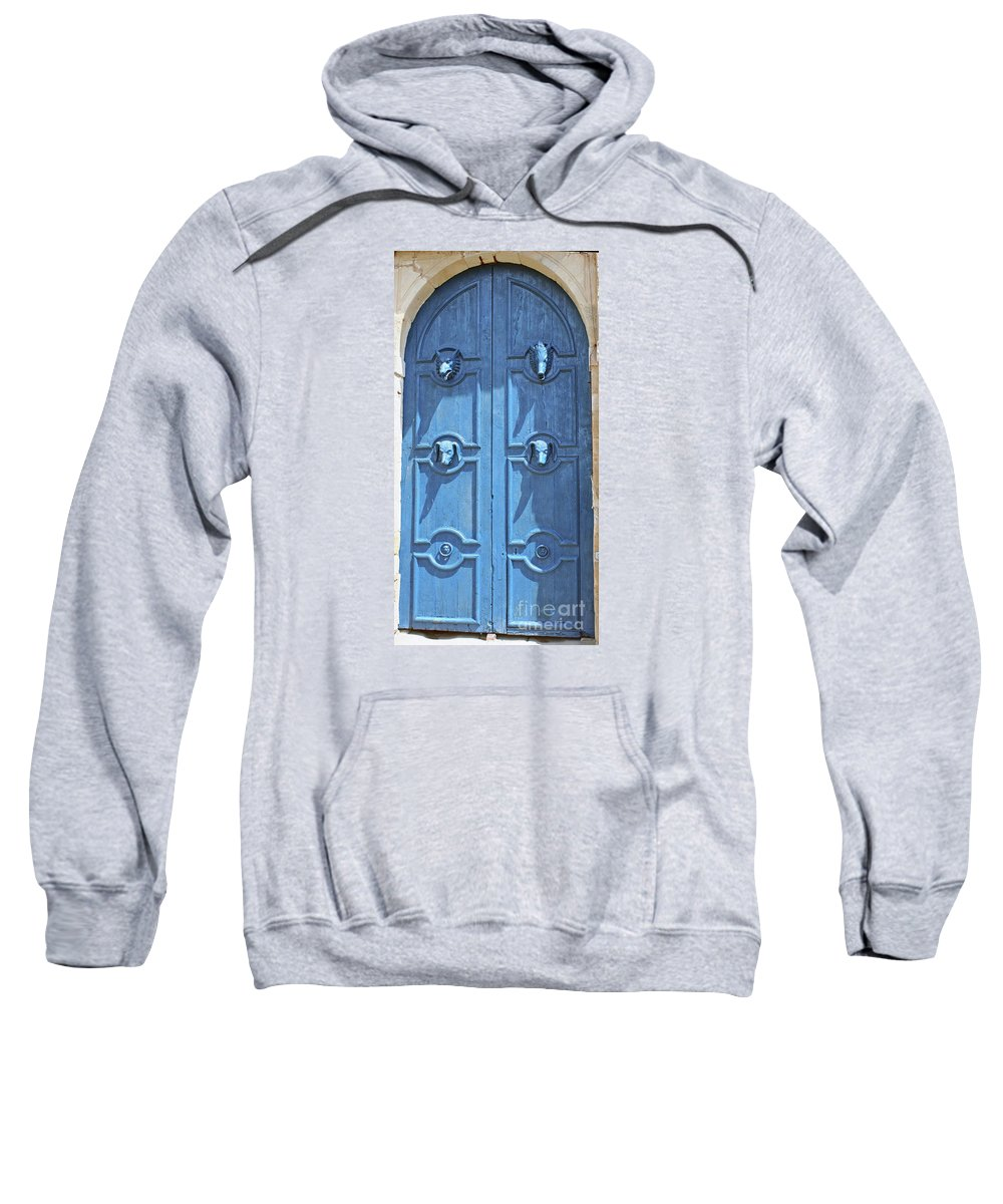 Blue Door Sweatshirt featuring the photograph Blue Door Decorated With Wooden Animal Heads by Christiane Schulze Art And Photography