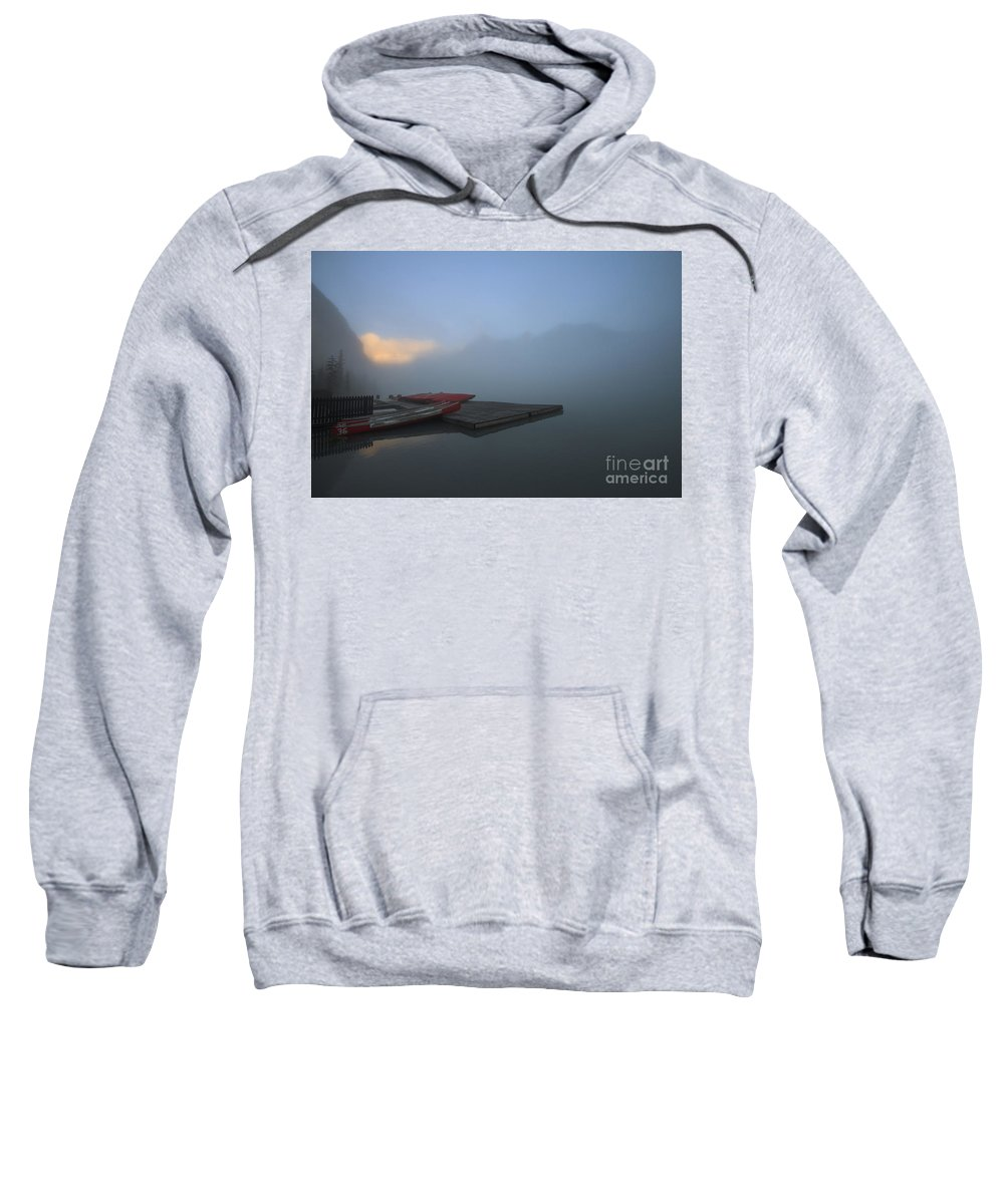 Lake Louise Sweatshirt featuring the photograph Lake Louise Canoes by Dennis Hedberg
