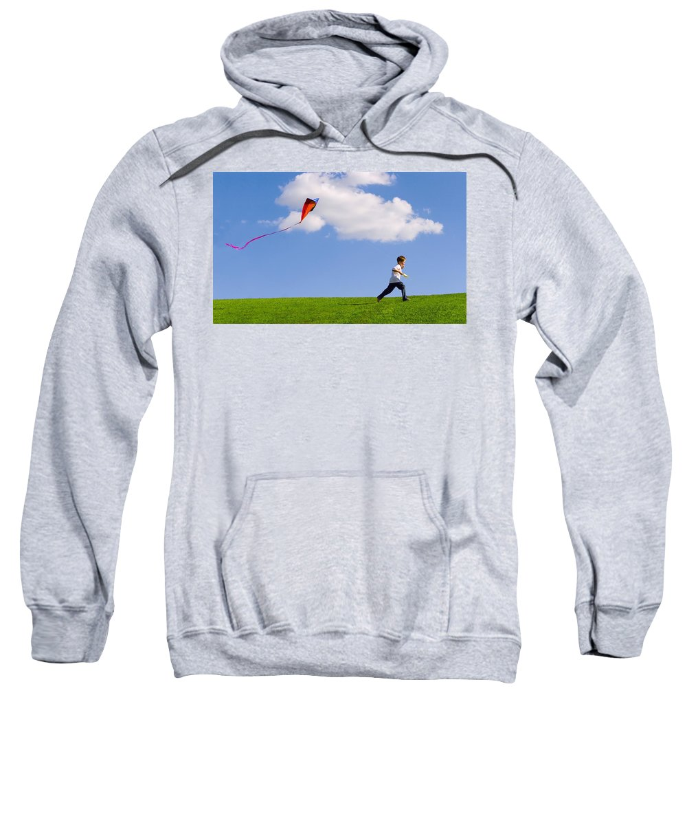 Lifestyles Sweatshirt featuring the photograph Child Flying A Kite by Don Hammond