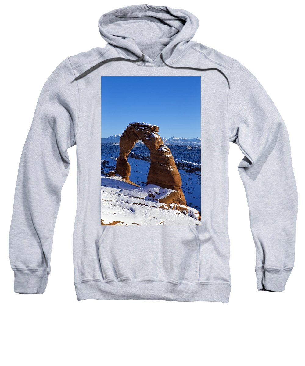 Arches Sweatshirt featuring the photograph Delicate Arch In Snow Arches National Park Utah by Jason O Watson