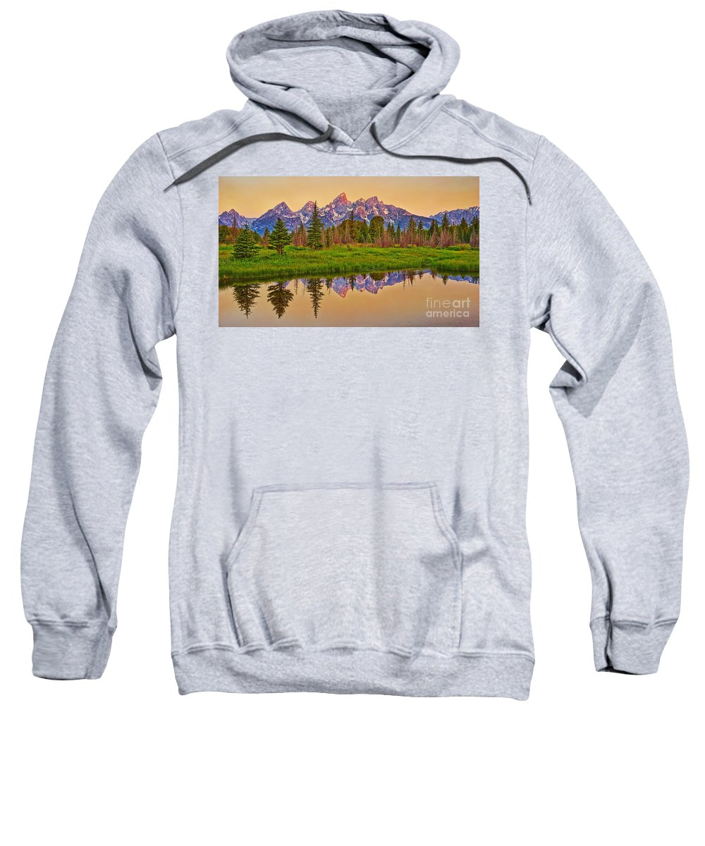 Alpine Glow Sweatshirt featuring the photograph Early Morning Warmth At The Tetons by Matt Suess